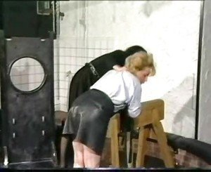 Slave in leather skirt is bend over by horny dominatrix with