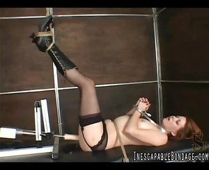 Girl tied and machine fucked