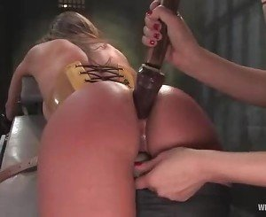 Nurse wearing bondage screws her patient up her tight ass usi...