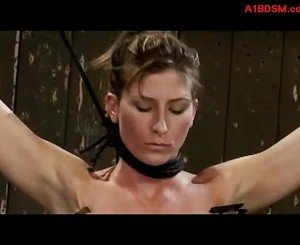Brunette Girl Tied Up Whipped Pussy Stimulated With Vibrator Body Tortured With Clips By Master And Mistress In The Dungeon