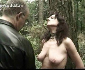 Naked slave tied to a tree got her pierced pussy played by m