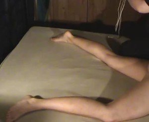 Trapped girl bound to the bed