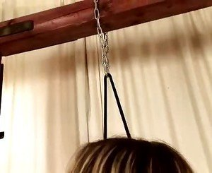 Cherry Jul chained and bound gagging on cock