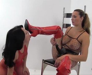 Horny babe in nylon licks lezdom boot and fucks strapon