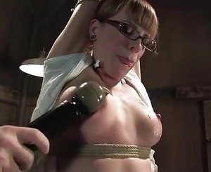 Strung up Dana Dearmond gets her puffy nipples teased with a...