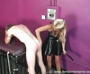 Strict Mistress Uses The Leather Paddle Onto Slave's Butt To Punish Him Big