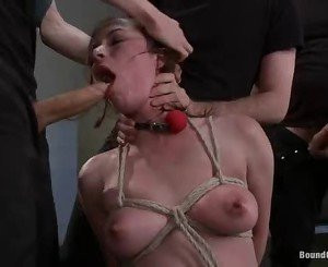 Bound Nicole Rider chokes on a huge throbbing cock