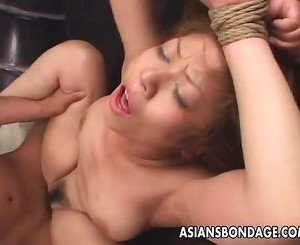 Tied up Asian gets fucked long and hard