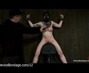 Bound babe with gas mask rides sybian