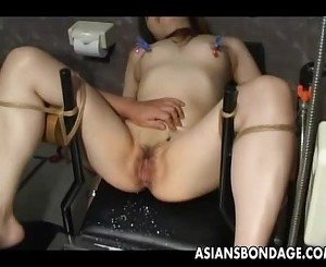 Japanese slave gets her wet pussy teased