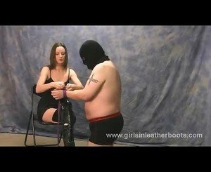 Hot mistress ties up slave for bondage and boot worship