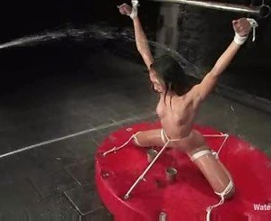Girl naked and bound on her knees whipped and soaked with wa