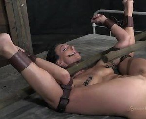 Bondage torment for brunette