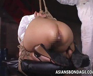 Hot Asian babe in bondage gets an enema