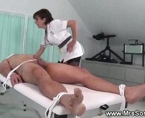 Dominatrix nurse healing a cock