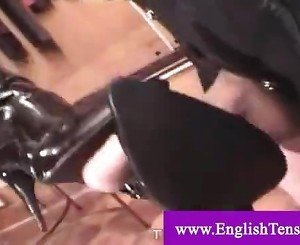 Domina punishes her leashed slave