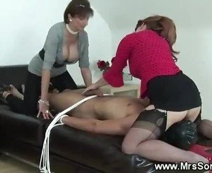 Glamorous dominatrix ruling a guy